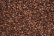 Coffee Beans Texture Or Coffee Beans Background. Brown Roasted Coffee Beans. Closeup Shot Of Coffee Beans. Many Coffee Beans. Coffee Beans Can Be Used As A Background. Fresh Roasted Coffee Beans.