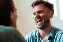 Man Laughing While Looking At Woman