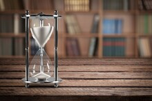 Antique Hourglass And Collection Of Old Books, History And Knowledge Concept