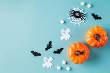 Halloween Ornate With Small Pumpkins Paper Ghosts And Spiders On Turquoise