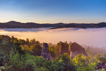 The Rock Towers Of The Dragons Garden (Gradina Zmeilor ), A Protected Geological Nature Reserve In Salaj, Transylvania Region, Romania, At Sunrise, In Summer Foggy Morning