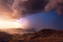 Dramatic Sunset Sky And Storm Over Lake Mead With A  Scenic Desert Landscape