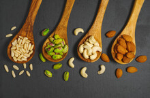 Assorted Mixed Nuts In Wooden Spoons