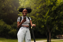 Beautiful African American Woman,riding Her Electric Scooter And Using A Mobile Phone