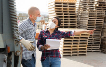 Man Worker And Woman Order Picker In Face Masks Collecting Order In The Warehouse Of Building Materials