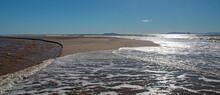 Small Sandbar Where The Pacific Ocean And The Santa Clara River Meet At Surfers Knoll Beach In Ventura California United States