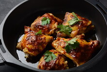 Roasted Chicken Leg Quarters Seasoned With Garlic And Herbs In A Baking Dish