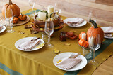 Fototapeta Kawa jest smaczna - Beautiful table setting with fresh pumpkins and fallen leaves near wooden wall
