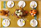 Fototapeta Kawa jest smaczna - Beautiful table setting with fresh pumpkins and fallen leaves in room