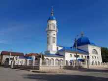 White Stone Muslim Mosque With A Blue Roof
