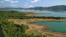 Aerial Drone Top Down Photo Of Beautiful Artificial Lake Of Plastiras Or Tavropos With Wonderful Nature And Famous Outdoor And Water Activities Like Canoe And Water Bike, Thessaly, Greece