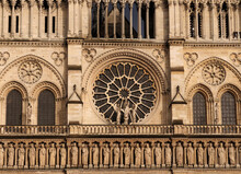 Beautiful Ornaments And The Rosette On The West Facade Of The Notre Dame Cathedral In Paris France On A Beautiful Spring Day