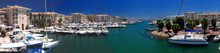 Luxurious Boats In The Yachting Harbour Of Frejus In Provence France On A Beautiful Summer Day With A Clear Blue Sky