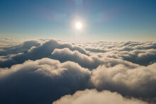 Aerial View From Airplane Window At High Altitude Of Dense Puffy Cumulus Clouds Forming Before Rainstorm In Evening.
