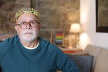 Hilarious Senior Man With Brat Expression Wearing A Crown