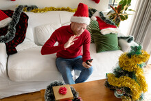 Albino African American Man Wearing Santa Hat Making Video Call With Christmas Decorations