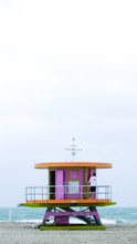 One Of The Iconic Lifeguard Towers Of Miami Beach, This One In Pink, Green, And Orange.