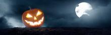 Pumpkin Jack O 'Lantern With Spooky Glowing Eyes On Halloween Night
