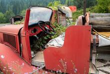 The Open Cab Of An Antique Fire Truck In A Junkyard, Idaho, USA