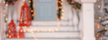 Beautiful Blurred Christmas Background In The Form Of Christmas Porch Out Of Focus For Background For Your Advertising