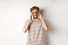 Handsome Young Man With Hipster Red Hairstyle And Glasses, Smiling At Camera, Standing Over White Background