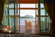 Inside Bedroom And Nature Sea View Background