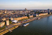Germany, North Rhine-Westphalia, Dusseldorf, Aerial View Of Riverside City At Dusk