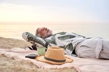 Mature Man Sleeping At Beach