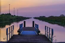 Orange Sun Sunset At The Boat Ramp In The Swamp