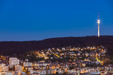 Germany, Baden-Wurttemberg, Stuttgart, Clear Sky Over City Suburb At Dusk With Television Tower In Background