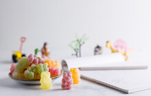 Sweet Candy Sour Bears. Sweet Candy,colorful Sour Bears Made From Sugar And Jelly On A Table Top With A Child's Drawing.