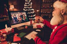 Side Photo Portrait Santa Talking To Friends On Webcam Burning Bengal Lights Wearing Glasses Sweater
