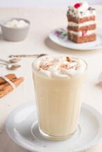 Eggnog Cocktail Against Cake Piece In Cafe