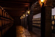 Old Wine Cellar With Corridor Between Barrels