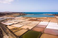 Salt Flats Against Lagoon And Ocean In Sunlight