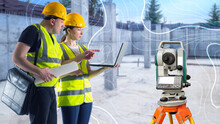 Optical Level Near By Two Surveyors. Engineering And Geological Surveys. Topographic Survey. Construction Site Topography. Surveyors With Modern Theodelites. Geodetic Works. Blurred Background.