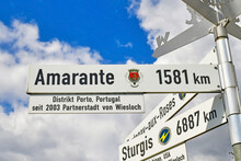 Wiesloch, Germany - August 2021: Road Sign Showing Direction And Distance To Twin City Amarante In Portugal