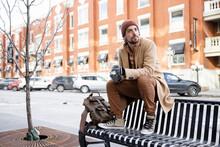 Portrait Handsome Stylish Man On Urban Winter Bench
