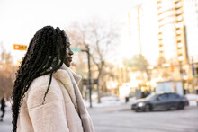 Beautiful Young Woman With Long Black Hair Crossing City Street