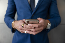 Close Up Businessman In Suit And Rings Using Smart Phone