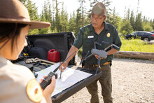 Ranger Preparing Drone With Map