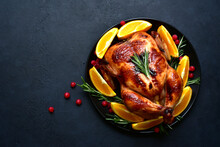 Roasted Christmas Chicken With Oranges ,rosemary And Cranberries . Top View With Copy Space.