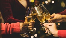 Beverage Glasses Clinking Moment By Cheerful Woman Friends On Sweater As Enjoy Celebrating Happy Relationship At Delightful Event Of Chirstmas Night Party