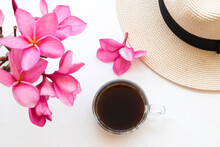 Hot Coffee Espresso, Pink Flowers Frangipani And Hat Of Lifestyle Woman Relaxation Arrangement Flat Lay Style On Background White