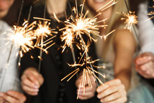 Out Of Focused Image Of People With Sparklers Celebrating  Holiday Or Event