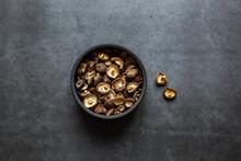 Dried Shiitake Mushrooms In Bowl On Dark Grey Background.
