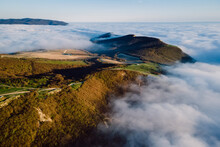 Aerial View With Creeping Clouds And Mountains In Anapa. Landscape With Fog