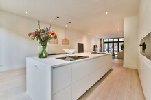 Modern Kitchen Interior With Flower Bouquet On Table In House