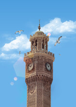Clock Tower And Birds In The Blue Sky