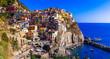 "Leinwanddruck Bild - Colorful fishing village Manarola- National Park ""Cinque terre"" in Liguria, popular tourist destination. Itlay travel and landmarks"